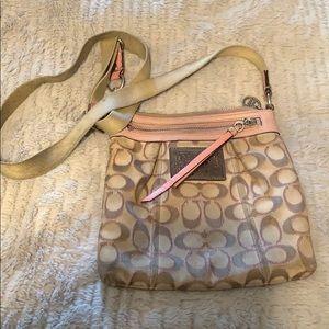 Tan and pink crossbody coach bag